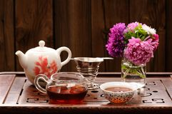 Bouquet of purple and pink asters and teaware for chinese tea ce Stock Images