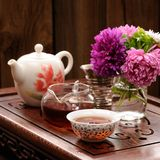 Bouquet of purple and pink asters and teaware for chinese tea ce Stock Photo