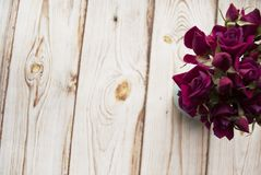 Bouquet of purple roses on a wooden background with copy space. Flat lay. Bouquet of purple roses on a wooden background with copy space. Flat lay Stock Images