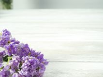 Bouquet from purple statice flowers on a white wooden table stock photo