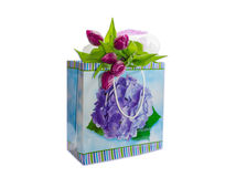 Bouquet of purple tulips on a paper bag with gifts Stock Photos