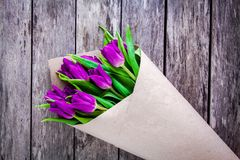Bouquet of purple tulips on a rustic background Royalty Free Stock Photography