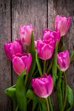 Bouquet of purple tulips on a wooden background Stock Photography