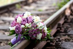 Bouquet on rail. Wedding bouquet on a rail Stock Photography
