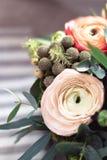 Bouquet of ranunkulyus on the window Stock Photo