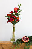 Bouquet of red calla lilies in a glass vase Stock Photos