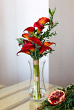 Bouquet of red calla lilies in a glass vase Royalty Free Stock Photography