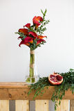 Bouquet of red calla lilies in a glass vase Royalty Free Stock Image