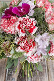 Bouquet of red carnations and purple orchid flowers Royalty Free Stock Photo