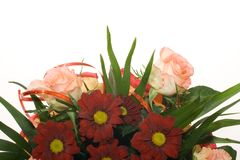 Bouquet of red flowers and pink roses. (detail) on white background Stock Photography
