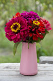 Bouquet of red flowers in a vase Royalty Free Stock Images