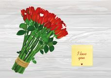 Bouquet of red flowers. Yellow sheet of paper for notes. Sticker. Empty space for your ad or inscriptions or messages. Valentine`s wedding and birthday. Free Stock Photography