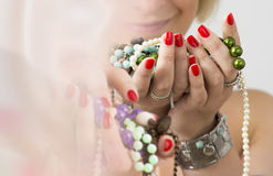 Bouquet of red nails and jewelry Royalty Free Stock Photo