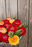 Bouquet of red and orange Ranunkulyus Royalty Free Stock Photos