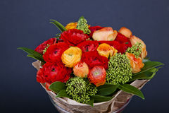 Bouquet of red and orange Ranunkulyus Stock Photo