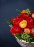 Bouquet of red and orange Ranunkulyus Royalty Free Stock Photos