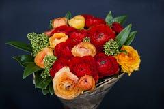 Bouquet of red and orange Ranunkulyus Stock Image