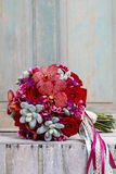 Bouquet with red orchid flowers, roses and succulents Royalty Free Stock Image
