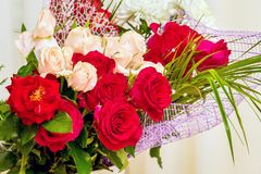 Bouquet of red and pink roses for greetings. Roses - a great gif royalty free stock image