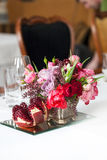 The bouquet of red and pink roses, peonies with grapes and pomegranates in the Dutch style Royalty Free Stock Photos