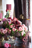 The bouquet of red and pink roses, peonies with grapes and pomegranates in the Dutch style Royalty Free Stock Photography