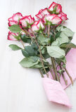 Bouquet of red pink roses with pink paper Royalty Free Stock Photography