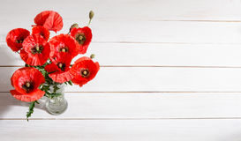 Bouquet of red poppies in glass vase Royalty Free Stock Photography