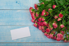 Bouquet of red roses with a card Stock Photo