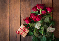 Bouquet of red roses on a dark wooden background. Stock Photos