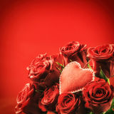 Bouquet of red roses with decorative heart. St Valentine's conce Royalty Free Stock Photography