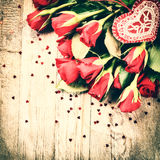 Bouquet of red roses with decorative heart. St Valentine's conce Stock Image