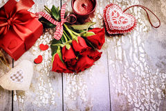 Bouquet of red roses with decorative hearts and presents. St Val Royalty Free Stock Image