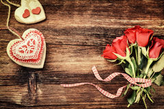 Bouquet of red roses with decorative hearts. St Valentine's conc Stock Photos