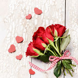 Bouquet of red roses with decorative hearts. St Valentine's conc Royalty Free Stock Images