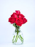 Bouquet red roses flower in glass bottle on  background Royalty Free Stock Image