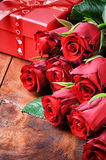 Bouquet of red roses and gift box Stock Images