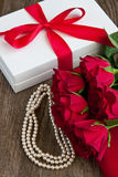 Bouquet of red roses and gift box , Valentines Day background Stock Image