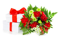 Bouquet of red roses with gift boxes Stock Photos