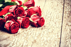 Bouquet of red roses on grunge background Stock Photos