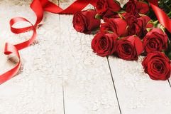Bouquet of red roses on grunge background Royalty Free Stock Images
