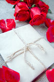 Bouquet of red roses and a letter, a note Royalty Free Stock Photography