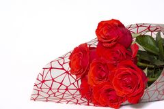 Bouquet of red roses lies on a white background stock image