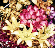 Bouquet with red roses, lily and orchid Stock Images