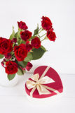 Bouquet of red roses with red gift box on white background Royalty Free Stock Images