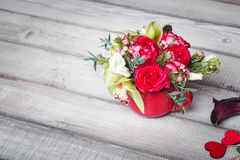 Bouquet of red roses in red vase, hearts, callas on table, space for text Royalty Free Stock Photos