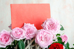 Bouquet of red roses with red wooden plank on table Royalty Free Stock Photos