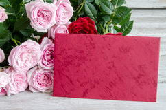 Bouquet of red roses with red wooden plank on table Royalty Free Stock Photo