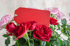 Bouquet of red roses with red wooden plank on table Stock Photography