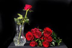Bouquet of red roses. With a rose in a vase Stock Image