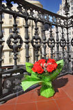 Bouquet of red roses stands on beautiful balcony Stock Photography